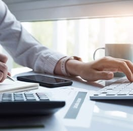 Businesswoman calculating VAT