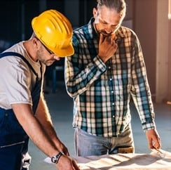 Two Builders looking over Construction Plans
